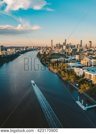 Sunset Aerial Shot Of Brisbane As A City Cat Heads Towards The City On The Brisbane River