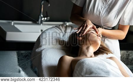 Wellness, Spa, Health And Massage Concept - Beautiful Woman Having Massage In Salon