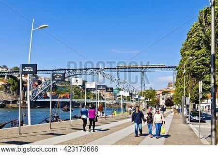 Porto, Portugal - June 19, 2019: View Of Vila Nova De Gaia Downtown In Porto City. Tourists Walk On