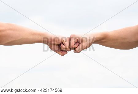 Fist Bump. Clash Of Two Fists. Concept Of Confrontation, Competition. Gesture Of Giving Respect Or A