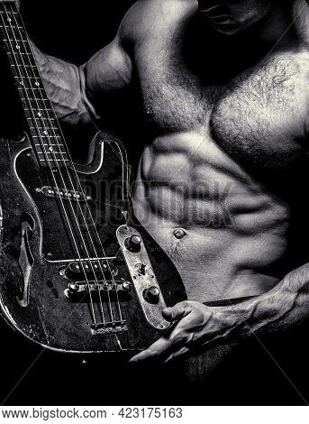 Electric Guitar. Torso Man. Instrument On Stage And Band. Strong, Muscular, Muscles Man, Bodybuildin