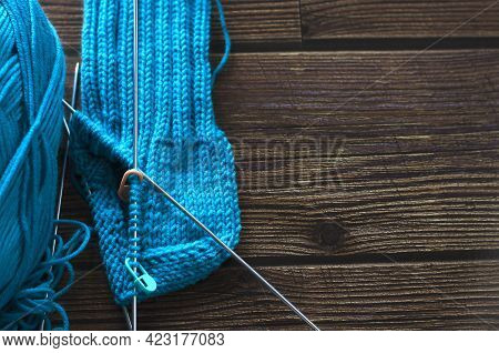 Knitting A Warm Sock From Blue Wool Yarn
