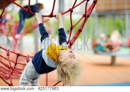 Perky Preschooler Boy Having Fun On Outdoor Playground. Spring/summer/autumn Active Sport Leisure Fo