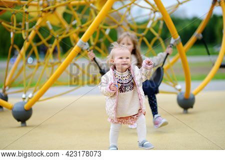 Two Child Having Fun On Outdoor Playground. Spring/summer/autumn Active Sport Leisure For Kids. Outd