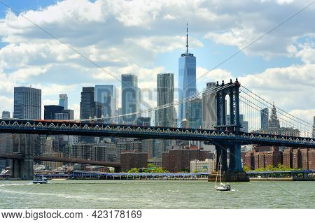 Famous Manhattan Bridge On The Background Of Skyscrapers. Postcard View Of New York, Usa. United Sta