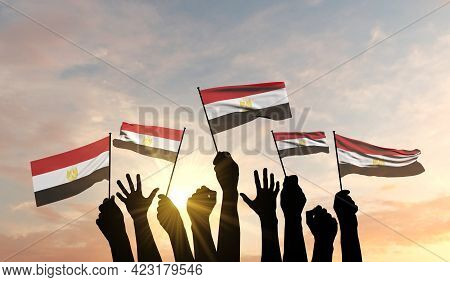 Silhouette Of Arms Raised Waving An Egypt Flag With Pride. 3d Rendering