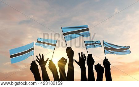 Silhouette Of Arms Raised Waving A Botswana Flag With Pride. 3d Rendering
