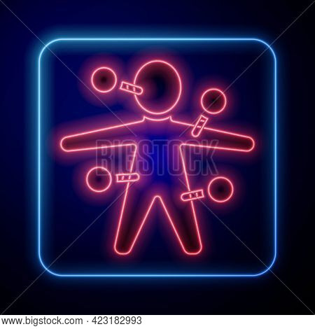 Glowing Neon Voodoo Doll Icon Isolated On Black Background. Vector