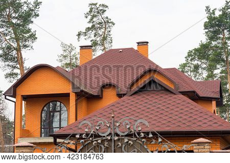 Construction Frame House Rain Gutter System And Brick Chimney Pipe On The Asphalt Roofing Shingles T