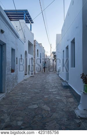 Koufonisi Island, Cyclades, Greece. Cobblestone Narrow Houses Background. Vertical.