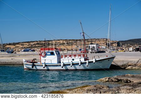 Moored Fishing Boat At Dock Background. Koufonisi Island, Cyclades, Greece.