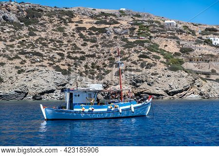 Fishing Boat Anchored On Blue Calm Sea. Greece, Cyclades.