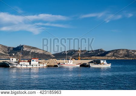 Moored Fishing Boats At Dock Background. Koufonisi Island, Cyclades, Greece.