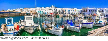 Greece travel. Cyclades, Paros island. Charming fishing village Naousa. view of old port with  boats and street taverns by the sea. may 2021
