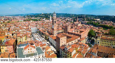 Torre Dei Lamberti Aerial Panoramic View. Torre Lamberti Is Tower In Piazza Delle Erbe Square In Ver