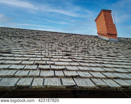 Wood Roofing - Roof With Old Wooden Shingles Against Blue Sky