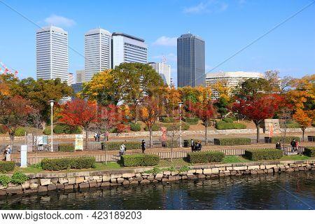 Osaka, Japan - November 22, 2016: People Visit Autumn Castle Park In Osaka, Japan. Osaka Belongs To