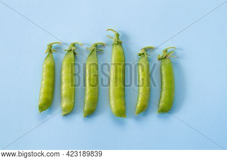 Pattern Of Green Peas On A Blue Background. Identity Concept. Pop Art Design, Creative Summer Food C