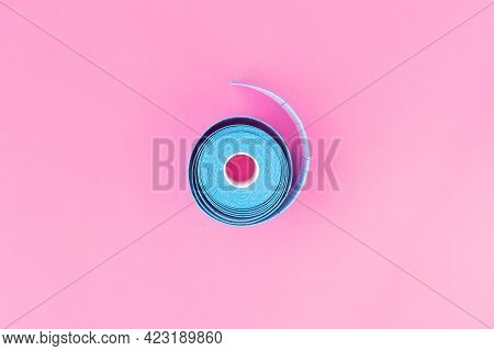 Blue Roll Of Kinesiology Tape On Light Pink Background With Copy Space, Flat Lay. Recovery, Anti-agi