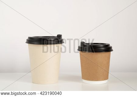 Two Coffee Cup Mockup On The White Background. Empty Cups For Americano And Cappuccino On The Table.