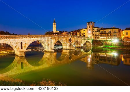 Ponte Pietra Bridge Is A Roman Arch Stone Bridge Crossing The Adige River In Verona, Veneto Region I