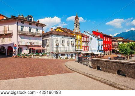 Ascona, Switzerland - July 10, 2019: Port, Church And Colorful Houses Located In Ascona City Near Lo
