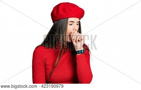 Young brunette teenager wearing french look with beret feeling unwell and coughing as symptom for cold or bronchitis. health care concept.