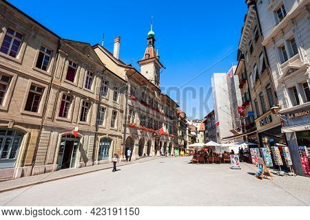 Lausanne, Switzerland - July 19, 2019: Place De La Palud Square With Fountain Is The Oldest Square I