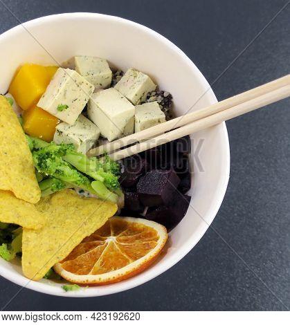 Poke Salad With Tofu, Quinoa, Mango, Beetroot, Broccoli, Orange And Chips