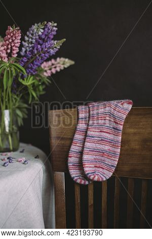 Hand Knitting Multicolored Socks On A Dark Background. Concept For Handmade And Hygge Slow Life.