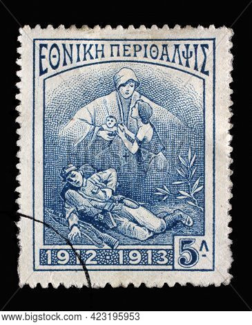 ZAGREB, CROATIA - JUNE 25, 2014: Stamp printed in Greece shows Dying soldier, widow and child, circa 1914