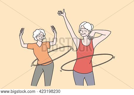 Elderly People Active Lifestyle Concept. Two Smiling Happy Healthy Mature Aged Women Friends Making