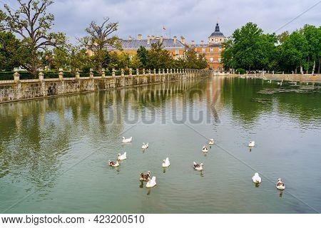 River Tagus As It Passes Through The Royal Palace Of Aranjuez With White Ducks In The Water.