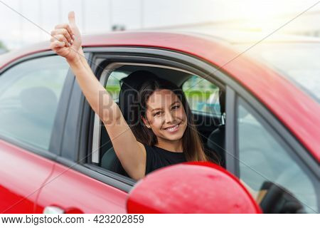 Car. Beautiful Woman In The Car Shows Thumbs Up. Happy Brunette In The Car.
