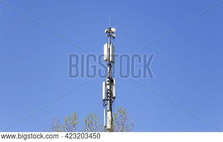 Communication Antennas, Radio Telephone Mobile Phone Antennas On Sky Background