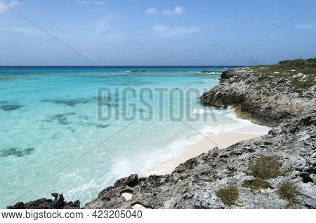The Scenic Or Rocky Half Moon Cay Coastline Surrounded By Transparent Waters (bahamas).
