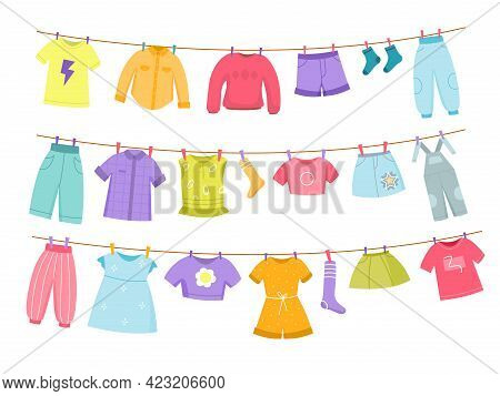 Kids Clothes Rope. Childish Color Dresses, Sweaters, Trousers And Skirts Clotheslines Dried, Washed
