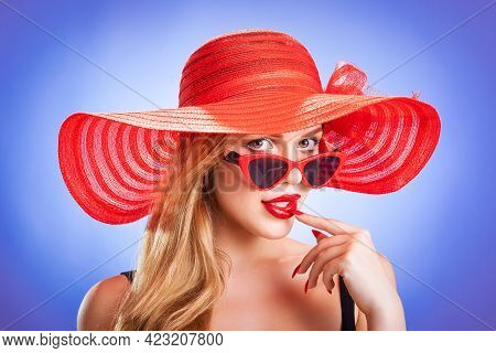 Young Beauty With A Red Straw Hat