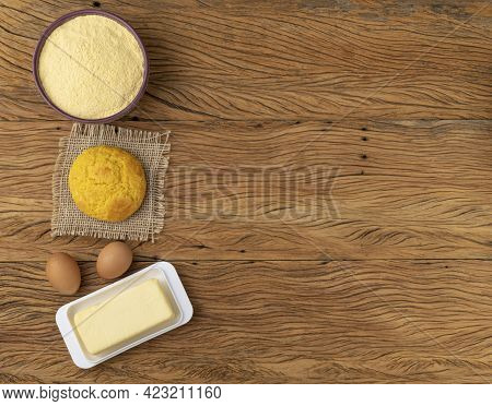 Broa, Typical Brazilian Corn Flour Bread With Ingredients. Butter, Eggs, Herbs And Fuba With Copy Sp
