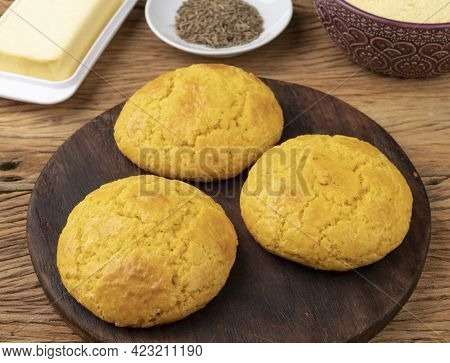 Broa, Typical Brazilian Corn Flour Bread With Ingredients. Butter, Herbs And Fuba, Corn Flour.