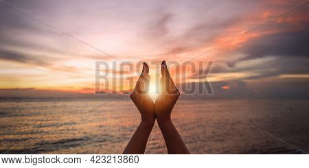 June Summer Sun Solstice Concept With Silhouette Of Happy Young Woman's Hands Relaxing, Meditating A