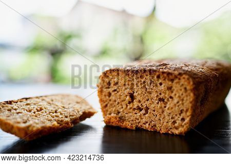 Fresh Yeast-free Home-baked Rye Bread On A Wooden Table