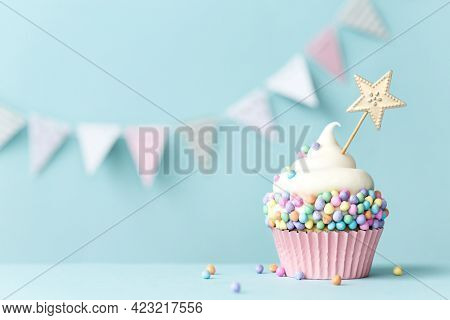Pastel celebration cupcake for a birthday party
