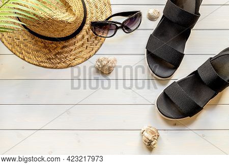 Summer Holiday Background, Flat Lay Beach Women's Accessories: Straw Hat, Black Sandals, Sunglasses,