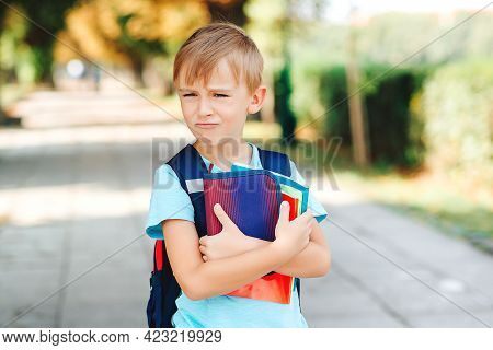 Little Student With Negative Emotions Go To School. Education, Back To School Concept. Unhappy Schoo