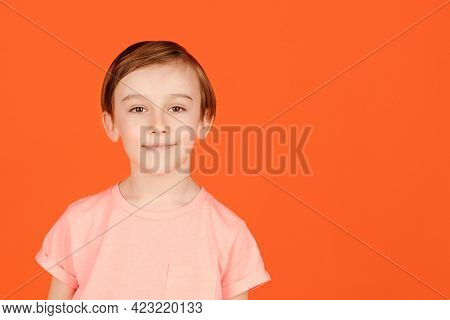 Cute Handsome Smiling Preteen Boy Posing At Studio. Portrait Of A Cheerful Young Boy. Child Dressed