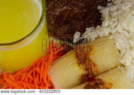 Brazilian Food Dish With Steak And Rice And Carrot And Cassava With Eye