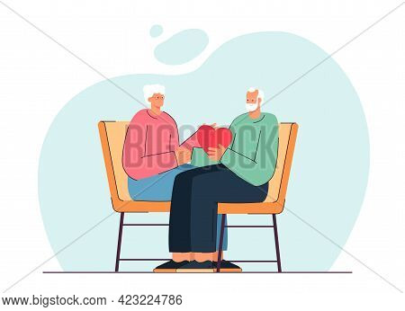 Elderly Couple Sitting And Holding Heart Together. Happy Husband And Wife Spending Time Together Fla