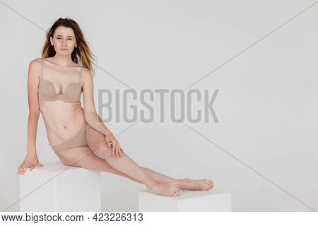 Slim Young Happy Woman With A Perfect Thin Waist. Diet And Healthy Lifestyle