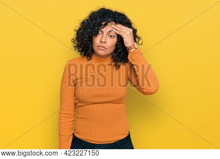 Young hispanic woman wearing casual clothes worried and stressed about a problem with hand on forehead, nervous and anxious for crisis